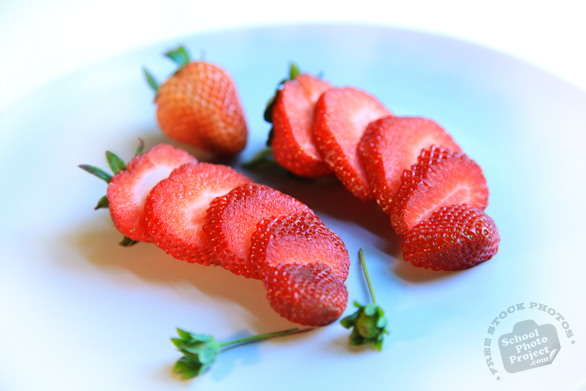 sliced strawberry, cut strawberry, stawberry photos, picture of strawberry slices, fruit photo, free stock photo, free picture, stock photography, stock images, royalty-free image