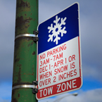 snow tow zone sign, no parking sign, weather sign, road sign, traffic sign, free stock photo, free picture, stock photography, royalty-free image