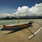 Lombok Island, Gili Meno Island, fisherman's canoe, sandy beach, seascape, cumulus nimbus cloud, Indonesia, Southest Asia, travel, tourism, travel photo, free photo, stock photo, stock photography, free picture, royalty-free image
